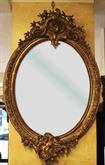 Antica specchiera dorata ovale francese